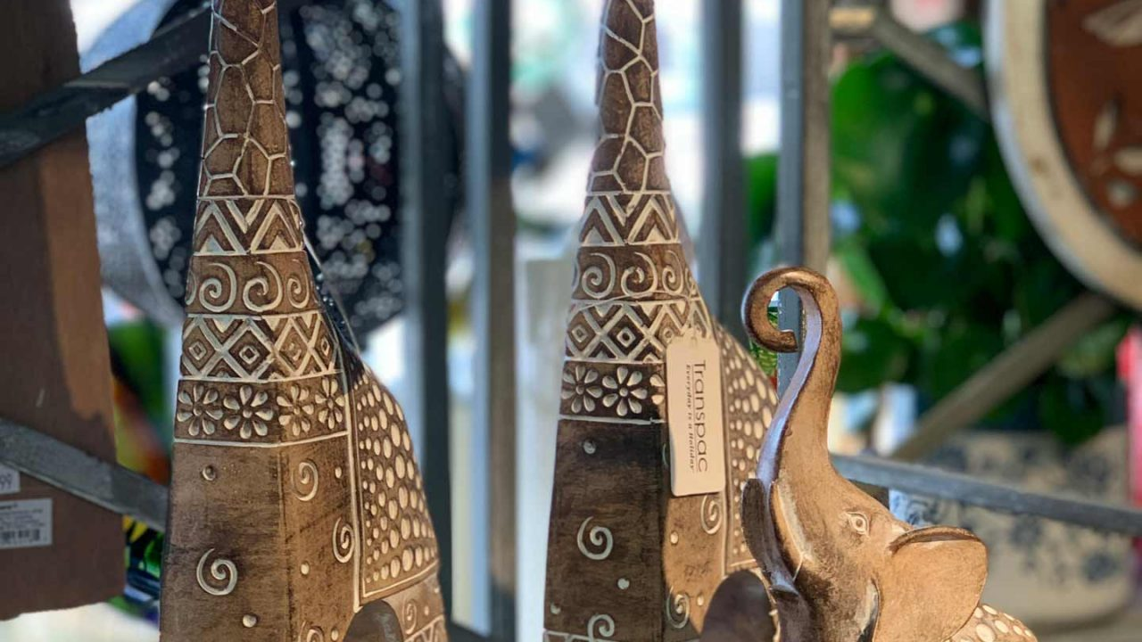 wooden statues of giraffes and elephants