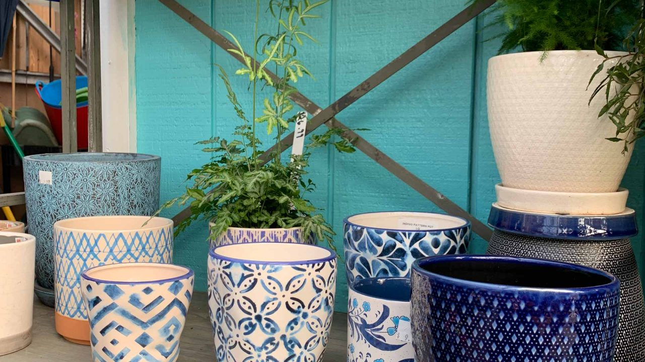 shelf filled with different patterned blue pots