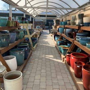 greenhouse aisle filled with assorted color pots